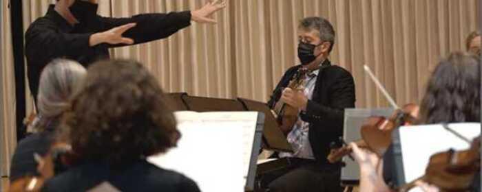 Lowell Chamber Orchestra music director Orlando Cela (left), and mandolinist Joseph Brent (right). Photo by Adam Noya